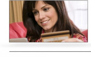 smiling woman holding gold credit card
