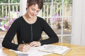 smiling woman managing finances