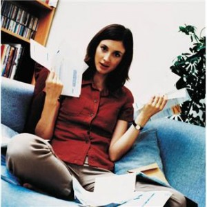 woman holding up bills