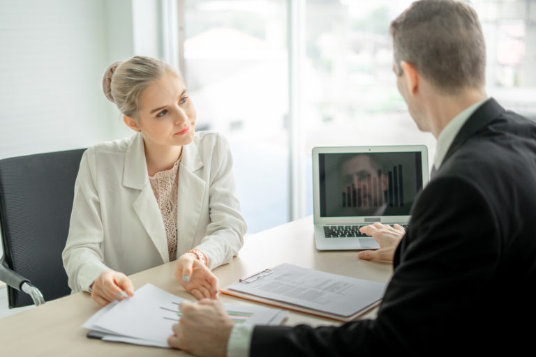 woman discusing if debt consolidation loan is right